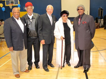 "Former Police Chief Earl Sanders, Fillmore Resident from the 40s to now, Abe Landry, entrepreneur Bunny Simon, Mrs. Leola King and local, award-winning saxophonist Bobbie ""Spider"" Webb gathered at Hamilton Gymnasium in 2010. Lance Burton writes: ""Bunny and I had put together a reunion of the kids who'd played at Hamilton when it was just an earthquake refugee shack during the late '40s. Hamilton was only outdoor field area where Black kids could play in the Fillmore until the mid-'50s."" – Photo: Lance Burton"