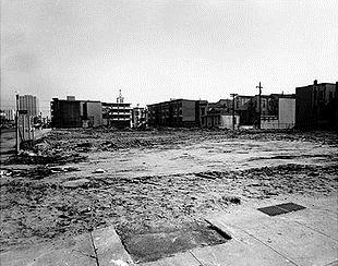 Just as Michael Brown's body was left in the street for four hours to show the Black community in Ferguson, Missouri, who's boss, Redevelopment not only laid waste to the Black Fillmore but left large swaths of it vacant for decades. – Photo courtesy of SF Library History Center
