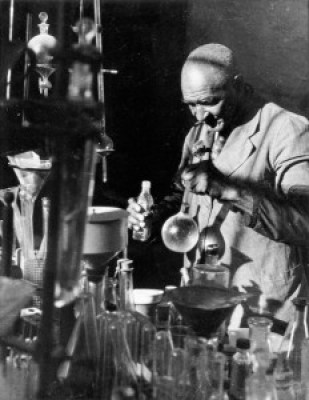 """George Washington Carver in His Lab,"" 1930, a gelatin silver photograph – Photo: P.H. Polk"