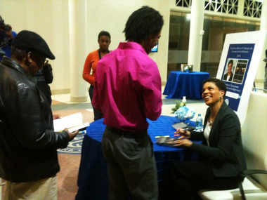 "After speaking in New Orleans, Michelle Alexander speaks with Dillard University student LeQuan Woods as she signs his copy of her book, ""The New Jim Crow: Mass Incarceration in the Age of Colorblindness."" – Photo: Naomi Martin, Times-Picayune"
