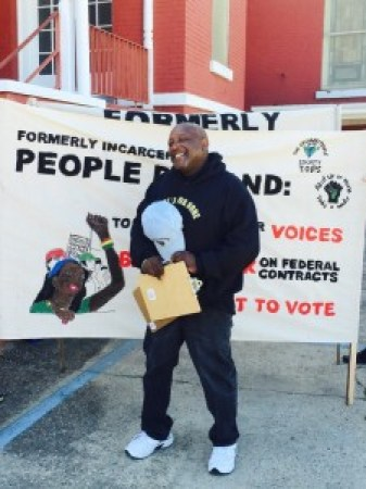 Dorsey Nunn brings Formerly Incarcerated People's Demands to Selma on their banner: 1) speaking in our own voices, 2) an executive order to Ban the Box for federal contractors and 3) the right to vote.