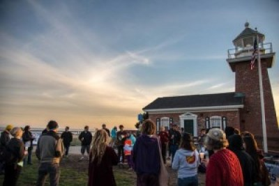 With the blessing of a beautiful sunset over the mighty ocean, Santa Cruz activists pause beside the old lighthouse for a moment of silence to end solitary confinement.