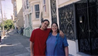 In happier times, Asa and his mom, Kat Espinosa, hang out in the neighborhood.