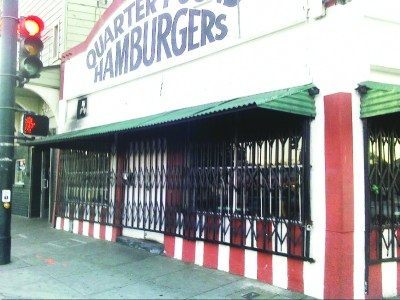 Whew! The gates are open again at Crown Burgers, Bayview Hunters Point's oldest eatery, and the burgers are back on the grill. Come by for SF's best burger! – Photo: Rochelle Metcalfe