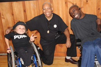 Kalyn Heffernan, Emmitt Thrower and Keith Jones are pictured at a Krip Hop Nation forum on police brutality against disabled people at Syracuse University.