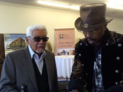 Legendary percussionist Pete Escovedo and Maestro Curtis check the playlist. – Photo: Rochelle Metcalfe