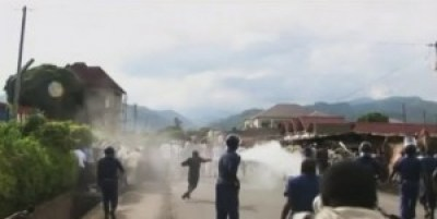 Burundian police disperse protestors with tear gas in Bujumbura, Burundi, on April 26, the day after President Nkurunziza's party nominated him for a third term.
