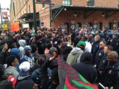 Protesters demanding an end to police brutality confront police at Camden Yards on Saturday, April 25. – Photo: Colin Campbell