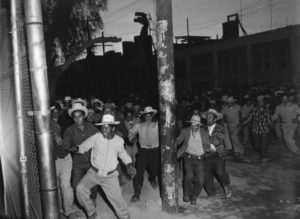 Mexican workers storm border Mexicali 020354 by UCLA Special Collections