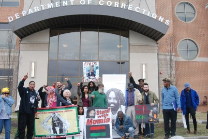 Supporters of Mumia Abu Jamal, who has come within an inch of losing his life in the past few days, gather outside the headquarters of the Pennsylvania Department of Corrections to demand he be evaluated and treated by outside doctors of his choosing.