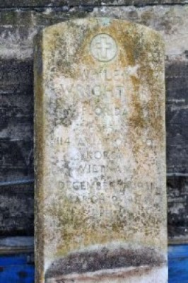 This is Sp5 Wyley Wright Jr.'s headstone in the North Jacksonville segregated cemetery, now deteriorating, that was his first resting place. – Photo: Will Dickey, Florida Times-Union