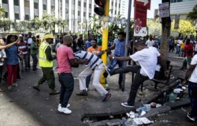 A local taxi driver is attacked during a confrontation with immigrants in the Johannesburg Central Business District on April 15. – Photo: Marco Longari