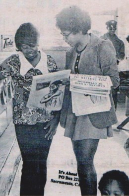 A Panther sister sells the paper in a laundromat. Panthers were passionate about informing the people.