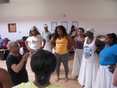 Blanche Brown talks with the dancers rehearsing for A Night of Tribute. – Photo courtesy of Congo SQ West