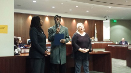 Baba Jahahara speaks at a Richmond City Council recognition event with then Vice-Mayor Jovanka Beckles and Mayor Gayle McLaughlin. Beckles and McLaughlin are now members of the City Council.