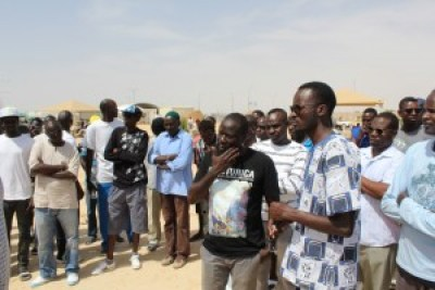 Mutasim Ali (white shirt with blue and black print) and other African asylum-seekers listen to expressions of solidarity from visiting African Hebrew Israelites and African Bedouin Palestinian citizens of Israel. – Photo: David Sheen