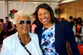 Two women with a lot of influence in San Francisco, Rochelle Metcalfe and recently elected Board of Supervisors President London Breed, chat at the Giants' VIP pre-game luncheon. The Black community pins high hopes on fast-rising political star London Breed. – Photo: Harrison Chastang