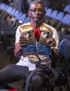 Andre Ward's veteran cut man Don Da Da displays Andre's victory gloves. – Photo: Malaika Kambon
