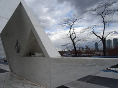 """The message inscribed on the Ark, """"Lest We Forget,"""" is our reminder to acknowledge the tragedy and consider the legacy. On the sides of the ramps are the names of the places Africans were transported from. Situated right on the East River and shaped like a ship, there is a certain movement also inherent within the work. It looks like it could fly away, the sides also ship-like. From the side, the Ark looks like the Sankofa bird (smile)."""