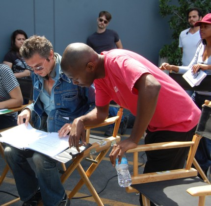 Paul and Dominique check the script.