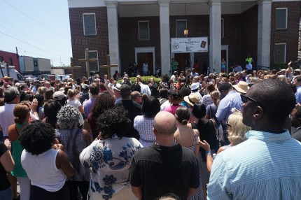 An overflow crowd gathers in front of Morris Brown AME Church for a prayer vigil on Thursday, June 18. – Photo: Paul Bowers