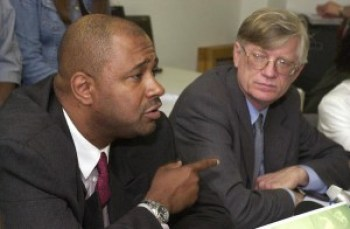 """In this June 26, 2003, news conference, former death row inmate Aaron Patterson and attorney G. Flint Taylor of the People's Law Office announced a lawsuit filed for his wrongful imprisonment. Taylor began representing Patterson, who'd been convicted of a double murder but had used a paper clip to crudely scratch a message on a police station bench saying: """"Aaron I lie about murders, police threaten me with violence ..."""" As Patterson's case was being appealed, then-Gov. George Ryan, days from leaving office, commuted the sentences of everyone on death row. He'd already halted executions when 13 inmates were found to have been wrongly convicted. – Photo: Jim Frost, Chicago Sun-Times"""