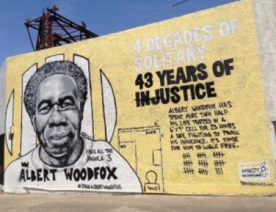 The stunning Albert Woodfox mural, just completed by Brandan Odums, is on the building at 537 S. Claiborne Ave. at Poydras in New Orleans. – Photo: Doug MacCash, Times-Picayune