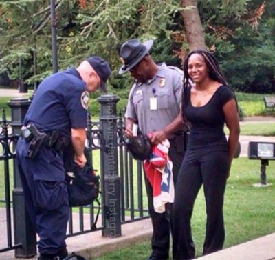 Bree Newsome is arrested after removing the Confederate battle flag from the South Carolina capitol grounds. – Photo: Danteberry, Instagram