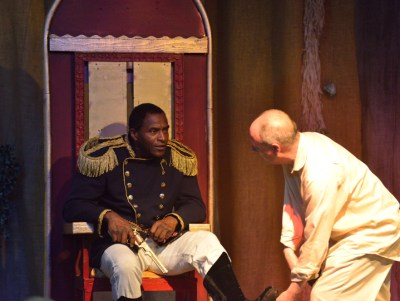 Carl Lumbly as Emperor Jones in a scene with Ted Speros