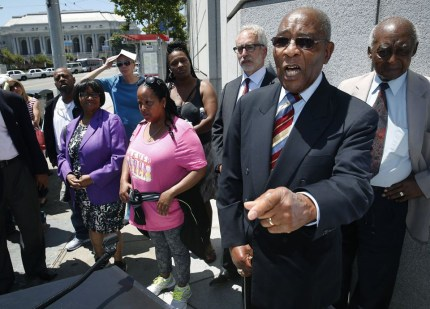 Rev. Dr. Amos Brown, pastor of the Third Baptist Church and president of the San Francisco NAACP, denounces plans by a nonprofit formed by the church to develop and operate affordable housing at Frederick Douglass Haynes Gardens to now sell the development to speculators. He spoke at a news conference and rally outside Superior Court on Tuesday, July 28. – Photo: Paul Chinn, SF Chronicle