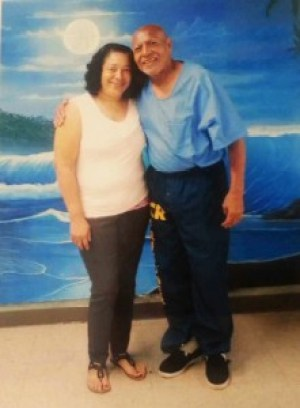 Allegra Taylor and her father, world renowned, beloved political prisoner Hugo L.A. Pinell, pose in the visiting room at New Folsom Prison just outside Sacramento on Aug. 2.