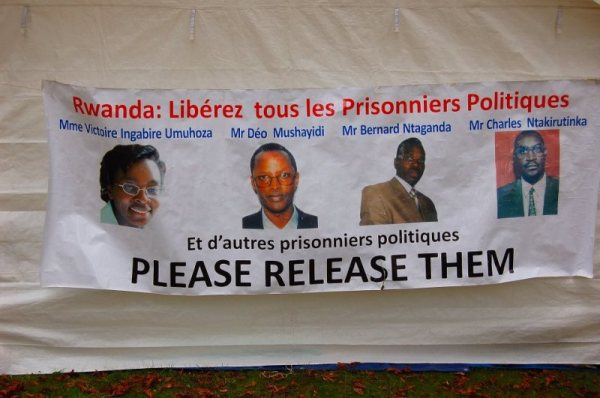 Shown on the banner calling for their release are Rwandan political prisoners, from left, Victoire Ingabire, Déo Mushayidi, Bernard Ntaganda, who was freed in 2014, and Charles Ntakirutinka.