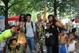 A number of Bay Area residents were at the International African Arts Festival this year alongside their East Coast family in Brooklyn on the Fourth of July. That's Xion in the Rebel Diaz shirt and her little brothers at the far right. – Photo: JR Valrey, Block Report