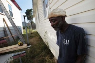 In this photo taken Aug. 26, 2011, Michael Cormick had been working with his son for six years to restore their home – with no help. – Photo: Chris Granger, New Orleans Times-Picayune