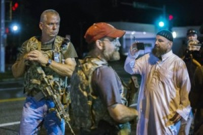 "Oath Keepers, former police, military and ""first responders,"" invade Ferguson on Aug. 11, two days after the first anniversary of Mike Brown's police lynching, showing off their ""open carry"" permitted weapons. – Photo: Lucas Jackson, Reuters"