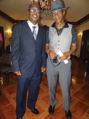 Robert H. King with John Thompson, founder of Resurrection After Exoneration at Glenn Ford's funeral. Glenn Ford (Oct. 22, 1949-June 29, 2015) was exonerated after 30 years in 2014 and died within the year. All three men served time at Angola State Prison, Thompson and Ford on death row. – Photo: Wanda Sabir