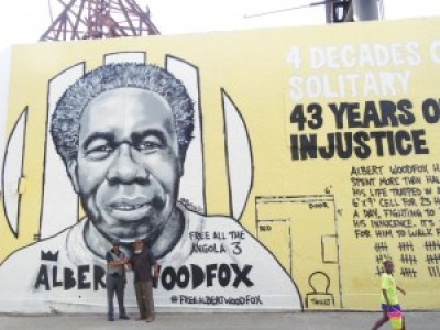 "Robert H. King and Malik Rahim in front of the new mural of Albert ""Shaka"" Woodfox – Photo: Wanda Sabir"
