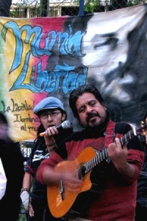 Jorge Salinas, former political prisoner, serenades the crowd during Mumia Solidarity Week in Mexico City, on Dec. 9, 2008. Supporters for Mumia are strong and very active in Mexico and also in several European countries.
