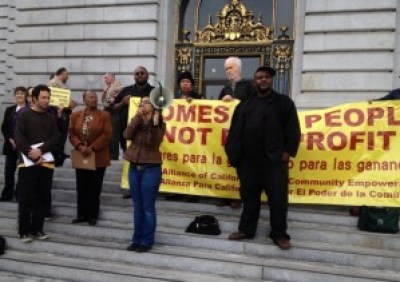 Tenants facing eviction hold a rally outside San Francisco City Hall in November 2013. The city's rent control law is not strong or comprehensive enough to stop unprecedented rent increases from driving all but the rich from San Francisco. – Photo: Bryan Goebel, KQED