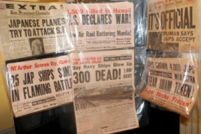 """San Francisco newspaper front pages report major World War II events. The """"300 Dead"""" headline refers to the Port Chicago explosion that killed 300 nearly all Black sailors loading munitions on a warship."""