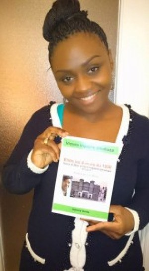 Gloria Ushema holds up her copy of Victoire Ingabire's book of prison notes.