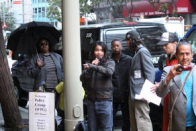 "POOR WeSearchers present their ""Broken Windows"" report outside the Marriott Marquis Hotel as ""Broken Windows"" Theory creator Richard Kelling was speaking to the Downtown Association's Conference inside. – Photo: Suze Leon, Poor News Network"