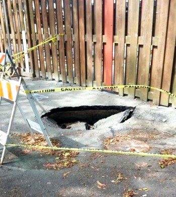 This sinkhole appeared behind the Starburst Barracks on Treasure Island after the vibro-compaction on May 28-29, 2015. – Photo: Sandra Washington