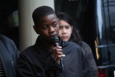 """Tyray Taylor, 13, a student at Deecolonize Academy, describes the oppression of children generated by """"Broken Windows"""" style private policing. – Photo: Suze Leon, Poor News Network"""