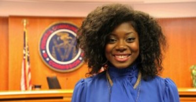 When Wandjell Harvey-Robinson, a member of the Illinois Campaign for Prison Phone Justice, was in third grade, both her parents were incarcerated – and prison phone rates made it difficult to stay connected. On Thursday, she celebrated at the FCC. – Photo: Center for Media Justice