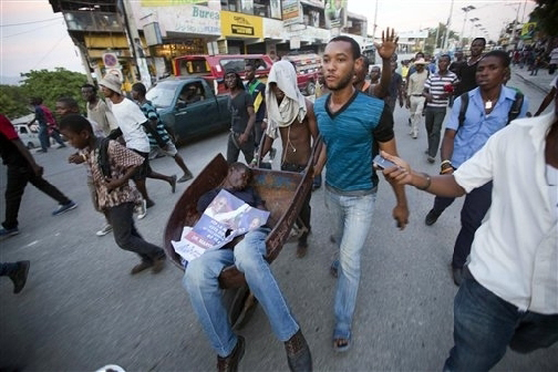 https://i0.wp.com/sfbayview.com/wp-content/uploads/2015/11/Anti-election-fraud-protesters-cart-man-killed-by-gunshot-Port-au-Prince-Haiti-112015-by-AP.jpg