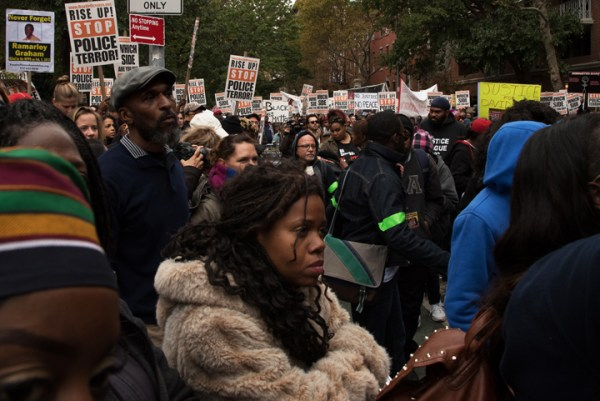 "The #RiseUpOctober crowd listens intently to the families of police murder victims. As of Nov. 16, exactly 1,000 people have been killed by police in the U.S. so far in 2015, including 183 in California, where the largest number have died, according to a database called ""The Counted: People killed by police in the US,"" compiled by the London Guardian newspaper. – Photo: William H. Jones Jr."