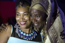 Dyimah Rogers and Nefertina Abrahms spoke of the life of Baba Tahuti, the unapologetically Black Man, pouring libation and giving thanks. – Photo: Malaika H Kambon