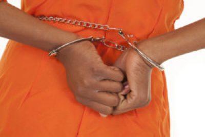 Woman prisoner hands shackled at waist