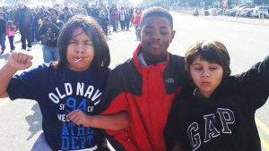 Deecolonize Academy students Kimo Umu, Tyray Taylor and Tiburcio Gray-Garcia Robles, who wrote the following reports, are shown here marching in San Francisco on Martin Luther King Day Jan. 19, 2015. – Photo: PNN